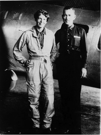 Amelia Earhart and Fred Noonan with the ill-fated Electra May 1937. Wikimedia Commons
