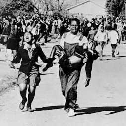 Hector Pietersen being carried during the Soweto Uprising. Wikimedia Commons