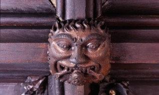 A grotesque mask on the ceiling of the Warden's Room, Chetham's Library