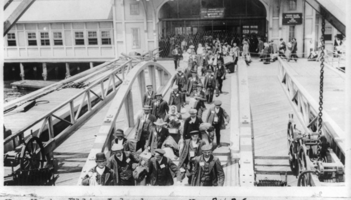When people take flight Irish Immigrants arrive at Ellis Island, New York in the early twentieth century. Library of Congress via pingnews
